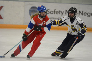 Marla Wheeler, left, of Calgary U14AA Crossfire keeps the ring away from Brooke Schultz of Airdrie U16A Sting in one of their regular season games at Murray Copot arena in Calgary on Sunday, Feb. 1, 2015. (Photo by Elizabeth Merritt/SAIT Polytechnic)