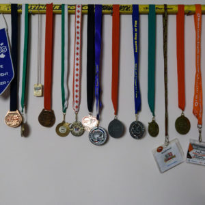 Using and old ringette stick to display your medals